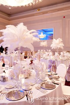 Beautiful White wedding reception with white feather plume centerpieces| Dayna Schroeder Photography