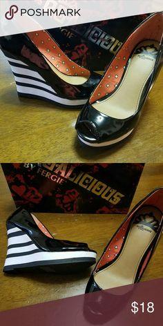 NIB Fergalicious Untold Black Patent Wedge sz 7 Extremely cute black patent wedge, black and white stripe heel, peep toe.  Fergalicious by Fergie. Original price $70.00 Fergalicious Shoes Wedges