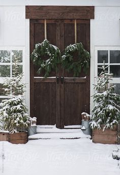 I love the double wreathes on the double doors. (Purchase this image at http://www.stocksy.com/420880)
