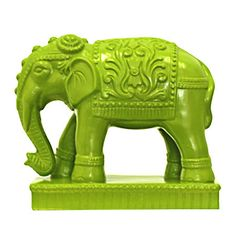 Ceramic elephant statuette in bright green.Product: Elephant statuetteConstruction Material:  CeramicColor...