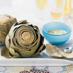 How to Prepare an Artichoke   Let's be honest, an artichoke is no easy veggie to figure out. Thankfully, with a little instruction, this confusing-looking flower is not so hard to cook after-all.