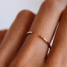 Otiumberg | 14kt yellow gold cuff ring by Lumo. Available online.
