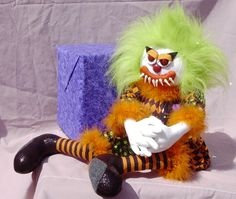 Evil KimB Klown with folded hands