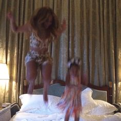 Beyoncé  jumps on a bed with daughter Blue Ivy in Italian getaway snaps | Daily Mail Online
