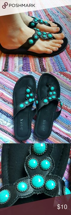 Black flip flops w/turquoise stones Soft black pipe flops with faux leather straps and turquoise stone embellishments.  😊 Very comfortable!😊  I have worn these many times, But you can also see from the first pic that they are still very very cute!  Size 8, but I usually wear a 7 1/2 and these fit me great! Shoes