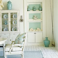 Our 50 Prettiest Island Rooms | Cool Hues | CoastalLiving.com  Built-in cabinetry with a touch of seafoam helps collectibles pop in this crisp white dining room. An oil-based exterior finish gives the painted cedar floorboards extra durability.