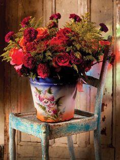 flowers in a fabulous enamel bucket on old chippy chair...love...