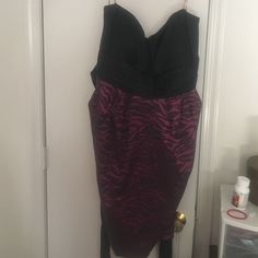 Zebra dress Strapless black and magenta zebra dress. With pockets and belt. Very comfortable. Bought from Deb. Worn once. Snap Dresses Strapless