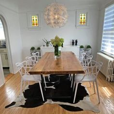 Keep your dining room looking fresh and light with our white Masters chairs and a live-edge Acacia table that looks like it's floating, thanks to U-shaped black legs and a well-placed rug. . Shop Now at www.wazofurniture.com . #furniture #interiordesign #design #interior #homedecor #furnituredesign #home #decor #sofa #architecture #interiors #homedesign #decoration #livingroom #art #wood #furniturejepara #vintage #mebel #luxury #furnituremurah #woodworking #interiordesigner #furniturejakarta Solid Wood Furniture, Furniture Design, Dining Chairs, Dining Table, Dining Room, Cement Table, Masters Chair, Mid Century Modern Sofa, Living Spaces