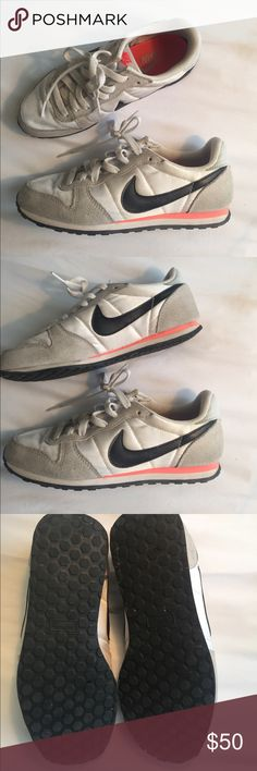 Nike casual sneakers size 7 Used but in great condition! Super comfortable walking shoes. White, grey, black, and pink. No trades, offers welcome! Nike Shoes