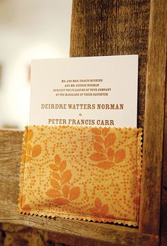 The letterpress-printed invitations were mailed to guests in fabric sleeves fashioned from varying textiles in autumn hues; the design was by Bird and Banner #weddinginvitations #weddingideas