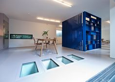 """The stairs sit between the kitchen and dining area on one side and the living space on the other side, providing a division, but with a degree of permeability,"""" explained architect Rashid Ali."""