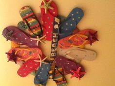 Flip flop wreath for tropical/beach themed classroom- buy flip flops at the dollar store!