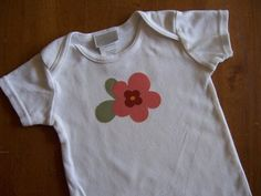 A couple weeks ago my neighbor had a yard sale where we bought four used onesies for 25¢ each. She has two boys, so most of the colors were blues or boy-style prints. I picked out a few plainer on...
