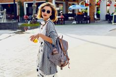 fashion  photo summer sunny lifestyle fashion portrait of young stylish hipster woman walking on the street