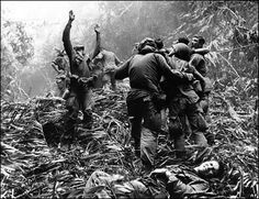 Vietnam war | Vietnam War = Hell ! « proud to be unknown  I think this picture is of soldiers carrying a wounded soldier that could have been in combat with the Vietnamese or was hurt by a booby trap I wonder where they are going.