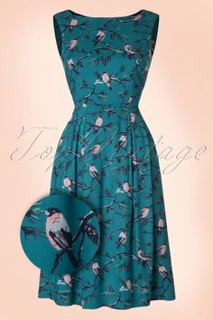 Be a pretty bird in this50s Penny A Little Bird Told Me Dress!  This cutie, is like all Emily and Din dresses, a real vintage fairytale! A super feminine silhouette, that's what you'll get thanks to the fitted top and flowy semi-swing skirt. She's not only a stunner to see but she's also very practical due to her side pockets; enough space for your favourite lipstick ;-) Made from a vintage blue viscose (doesn't stretch!), is fully lined with cotton and covered with cute little R...