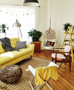 yellow | black and white | ladder | creative | plants | pot plants | throw rug | accents | light | bright | metallic | hanging chair | rug | timber | warm | cushion | floor boards | living space | living room | lounge room | design | home | house | decorating | dream