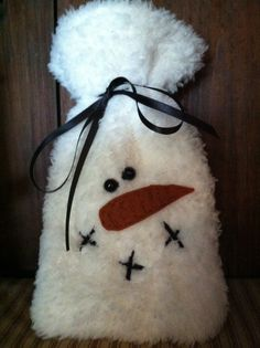 Fuzzy snowman gift bags .