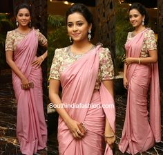 Sri Divya in a plain pink crepe saree teamed with floral embroidered blouse