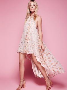 Charm School Printed Dress | Featuring dropped armholes this flowy and printed dress has a high low hem with decorative floral accents.  Adjustable high neck with slit detailing along the front and back bodice.  Lined.