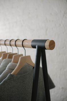 """The Alta Clothes Rack's slim profile and minimal details brings function and a touch of order to the corner of your bedroom. Made of heavy-gauge powder-coated steel legs and a 1.5"""" diameter solid oak rail."""