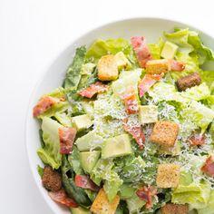 Avocado Caesar Salad Recipe Salads with avocado, lemon, olive oil, anchovy paste, parmesan cheese, dijon mustard, garlic, romaine lettuce, bacon, avocado, croutons, parmesan cheese