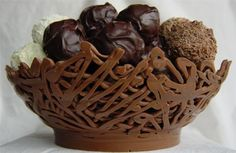 Chocolate lattice bowl filled with chocolateschocolala.co.uk