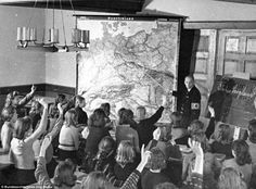 In October 1940, this photograph of a school in the Silesia region of Poland, shows a teacher wearing a Nazi uniform. The school curriculum changed after Hitler came to power, focusing on racial biology and population policy
