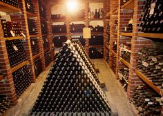 Wine bottle pyramids in wine cellar. I'm a little concerned about the safety of this wine. Caves, Wine Vault, Alcohol Dispenser, Winery Tasting Room, Home Wine Cellars, Wine Folly, Wine Cellar Design, Expensive Wine, Secret Rooms