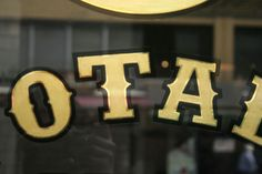 Close up of Totale gold leaf gilded sign. Thick black outline brings out the bling bling!