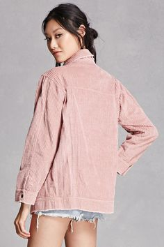 A casual jacket crafted from a thick corduroy featuring a basic collar, snap-buttoned front, flap chest pockets, front slant pockets, and long buttoned cuff sleeves. This is an independent brand and not a Forever 21 brand.