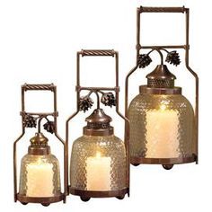 """Cast a warm glow in your entryway or sunroom with this 3-piece metal candle lantern set, featuring an antique copper finish and pinecone-inspired accents.   Product: Small, medium and large lanternConstruction Material: Metal and glassColor: Antique copperFeatures: Honeycomb texturedAccommodates: (1) Candle each - not includedDimensions: Small: 14"""" H x 6.25"""" DiameterMedium:  17.5"""" H x 8"""" DiameterLarge: 19"""" H x 9.5"""" Diameter"""