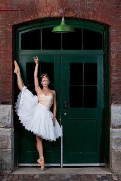 Ballet dancer near a green door