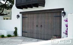Dynamic Garage Door - Santa Ana, CA, United States. Spanish Style Wood Garage Door Handmade in Solid Vertical Grain Doug Fir. Decorated with Spanish Style Iron Straps, Clavos and Pull Rings! Garage Door Colors, Garage Door Windows, Diy Garage Door, Modern Garage Doors, Wood Garage Doors, Garage Door Makeover, Garage Door Design, Barn Garage, Garage Ideas