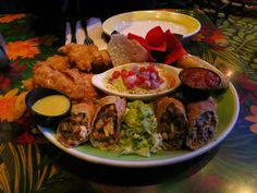 Recipe for an Awesome Appetizer Adventure at Rainforest Cafe: Chimichangas, Spinach and Artichoke Dip, Cheese Sticks, Chicken Strips and Guacamole Disney Food, Disney Recipes, Recipe Chicken, Chicken Recipes, Rainforest Cafe, Oil For Deep Frying, Chimichanga, Canned Black Beans, Roasted Peppers