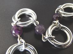 Amethyst Mobius Bracelet from Aberrant Ginger. February birthstone jewelry or the perfect bridesmaid gemstone gift. Australian based chainmaille jewelry.