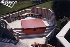 Deck higher in the back and lower in the front. I woukd want steps just on one side but about 4-5' wide, then enclosed on the other side and at the back with decking overlapping the HT edging for a built in look. Open at the front for service access. Needs to be able to slide out.