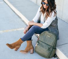 MZ Wallace Metro Backpack, white tunic, haute off the rack, Marc Fisher booties, plum colored handbag, brown booties, ankle booties, fall outfit, olive vest, Sanctuary GiGi vest, fashion blogger, @hudsonjeans, grey jeans, travel style, fall fashion, women's fashion, fall travel outfit,