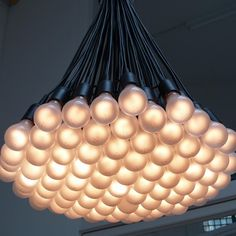 The iconic '85 Lamps' Chandelier by Droog gets an eco-friendly LED update. This LED version uses 85 pieces of dimmeable