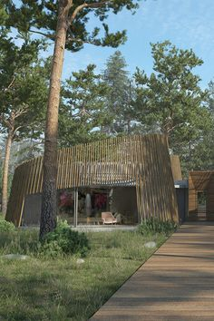 Old and modern architecture merge to create the design of this rustic house set in a forest in Ireland.  Inspired by the historical Celtic roundhouse the exterior structure is shrouded with a wood trellis-style cladding to create the conical round shape. The interior design is minimal with concrete walls, modern furniture, colorful artwork and accessories. | #forest | #Entrance | #eco |