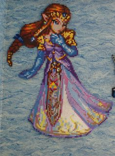 A bead sprite of Zelda made of Perler and Hama beads. I just had to make this to go with my Sheik sprite. The original sprite was made by the amazing ar. Perler Beads, Fuse Beads, Pearler Bead Patterns, Perler Patterns, Pixel Art, 8bit Art, Hama Beads Design, Iron Beads, Geek Crafts