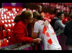 Canada midfielder Chelsea Stewart is consoled by a family member after losing in extra time to the United States on Aug. 6, 2012. (Mark J. Rebilas/USA TODAY Sports)