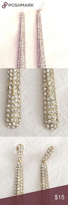 """Tear Drop Gold Plated Rhinestone Earrings Brand new out of my personal closet. Tear drop gold plated earrings for pierced ears. Rhinestones are not perfectly set but they firmly secure in their setting. Earring drop measure 3 1/2"""" and 1/2"""" wide. Jewelry Earrings"""