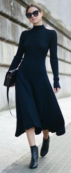 Zina Charkoplia absolutely smashes this gorgeous midi sweater dress.  Dress: Celine, Boots: Acne, Sunglasses: Celine, Bag: Saint Laurent.