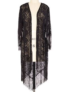 My inner goth-witch may need this...  The Outer Fringe Lace Sweater at PLASTICLAND