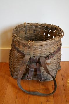 <3 this old basket with leather straps We have an old L.L.Bean like this.  Gorgeous patina.  K.W.