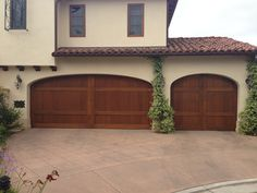 Custom Wood stain grade sectional garage doors installed in San Diego. Beautiful natural wood, Template arch top section. This is one of my most favorite garage doors. www.castleic.com Energy Efficient Insulation, Building A House, Door Installation, Staining Wood, Garage, Sectional Garage Doors, Garage Service Door, Outdoor Decor, Custom Wood