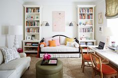 office, bookcases, two sconces lighting a daybed, bright whites