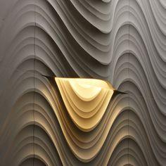 Curved stone slab with a true spotlight: SETA CURVE LUCE by LITHOS DESIGN | Design Raffaello Galiotto (2012) #light #stone #3Dsurface